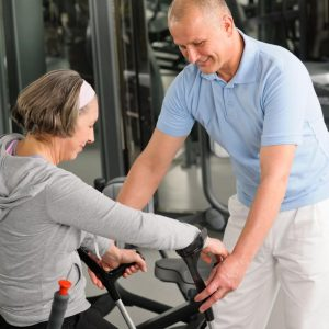 senior-woman-with-crutches-getting-help-of-physiotherapist-at-gym_stovpntno